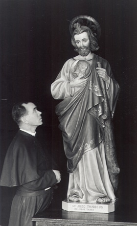 Fr. James Tort, CMF and the original St. Jude statue.