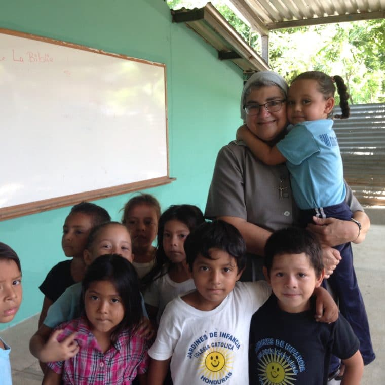 """Sister Ondina with children from one of the early childhood centers in the """"bordos""""(shanty towns) of San Pedro Sula, Honduras."""