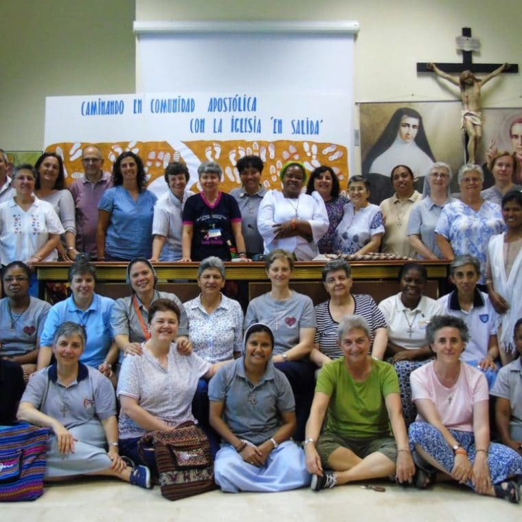 Claretian Missionary Sisters' General Chapter, along with lay collaborators and pictures of the founders on the back wall.